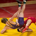 Iowa State University's Gabe Moreno tries to turn UNI's Gunnar Wolfensperger in the 149-pound match on Feb. 15, 2015, during their dual meet at Hilton Coliseum in Ames.