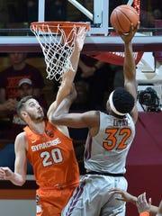 Syracuse's Tyler Lydon defends Virginia Tech's Zach LeDay in Blacksburg, Virginia on Jan. 10.
