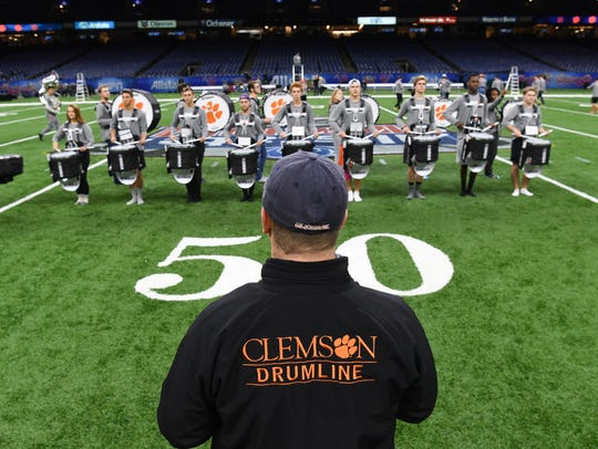 The Tiger Band drumline practices in the Superdome