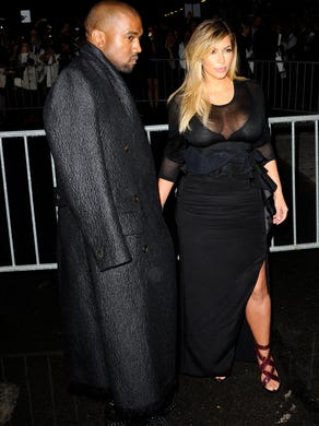 West and Kardashian turn up for Givenchy's ready-to-wear Spring/Summer 2014 fashion collection on Sept. 29, 2013 in Paris. The couple is friends with the brand's designer, Riccardo Tisci.