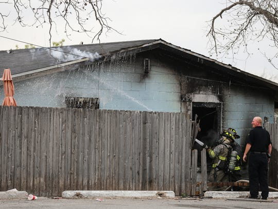 San Angelo fire fighters battle a blaze Thursday, March