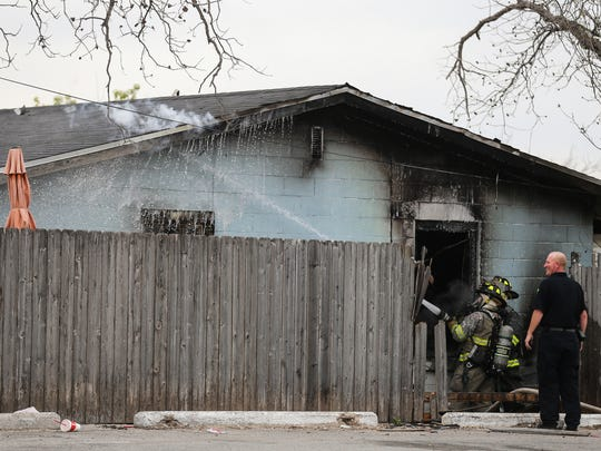San Angelo fire fighters battle a blaze Thursday, March 15, 2018, at 1623 Beacon St.