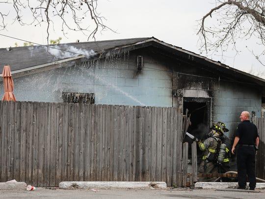 San Angelo fire fighters battle a blaze Thursday, March