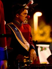 A South Salem High School marching band member gets ready for the 2014 Festival of Lights Parade.