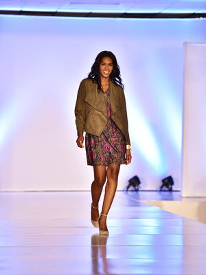 Tinika Blackmon models during the Stepping Out in Style Fashion Show fundraiser. The show featured professional and local models, with fashions from Bluetique, cabi by independent stylist, Jennie Barrow, duh for garden & home, The Market and Mainly Shoes, and The South Outfitters.