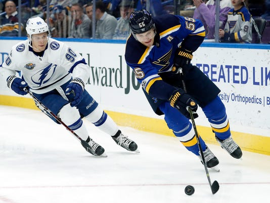 St. Louis Blues' Colton Parayko, right, controls the puck as Tampa Bay Lightning's Vladislav Namestnikov, left, of Russia, gives chase during the first period of an NHL hockey game Tuesday, Dec. 12, 2017, in St. Louis. (AP Photo/Jeff Roberson)