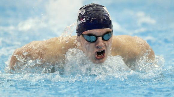Pittsford's Sam Roche wins the 200 yard individual medley with a time of 2:04.98.