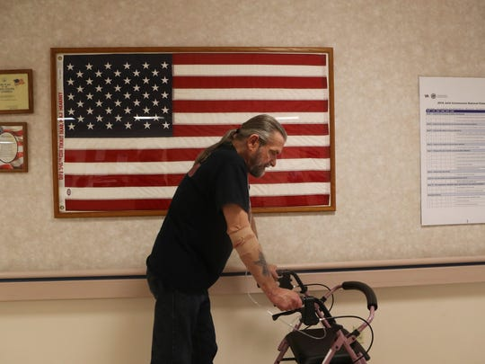 Richard Chaviers, a Vietnam Veteran, walks out of the
