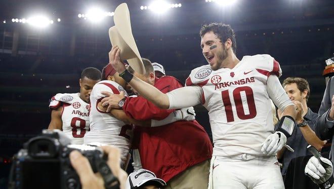 Arkansas  quarterback Brandon Allen celebrates the victory against Texas  at NRG Stadium.