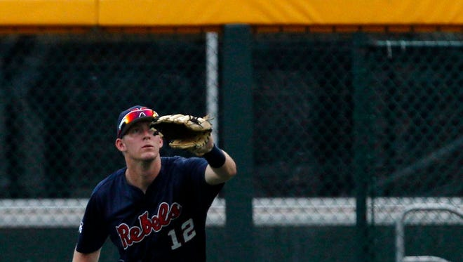 Outfielder J.B. Woodman (12) catches a fly  ball in the game against the Virginia Cavaliers during game twelve of the 2014 College World Series at TD Ameritrade Park. He was named an All-American for the second time Monday morning.