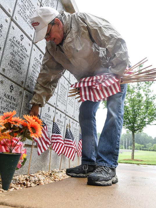 Veterans place flags at Dolly Cooper for Memorial Day