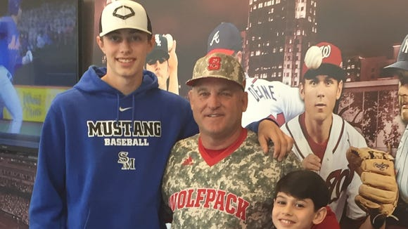 Smoky Mountain junior Cole Hooper, left, has committed to play college baseball for N.C. State. He is pictured here with Wolfpack coach Elliott Avent and Hooper's younger brother, Ethan.