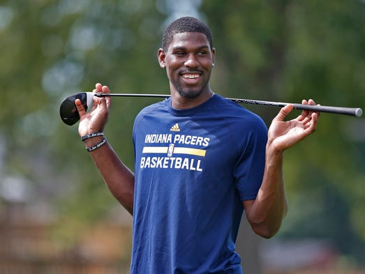 Alex Poythress warms up to tee off at the Pacers Golf