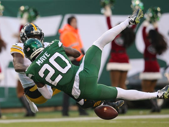 Dec 22, 2019; East Rutherford, New Jersey, USA; New York Jets safety Marcus Maye (20) breaks up a pass in the end zone intended for Pittsburgh Steelers wide receiver James Washington (13) during the fourth quarter at MetLife Stadium. Mandatory Credit: Brad Penner-USA TODAY Sports