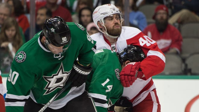 Detroit Red Wings left wing Henrik Zetterberg (40) ties up Dallas Stars left wing Jamie Benn during the second period at the American Airlines Center.