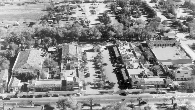 A 1936 aerial shot of La Plaza with the theater on the left and garage on the right.
