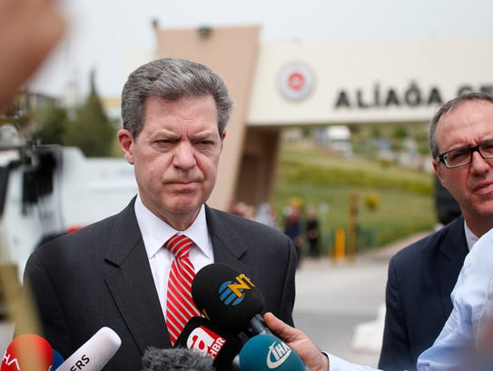 Samuel Brownback, US Ambassador-at-Large for International Religious Freedom, talks to members of the media outside the prison complex Aliaga, Izmir province, western Turkey, where the trial of jailed pastor Andrew Brunson began Monday.