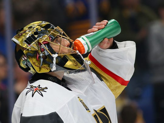 Vegas Golden Knights goaltender Marc-Andre Fleury takes a drink during the second period of Saturday's 2-1 shootout victory over the Buffalo Sabres.