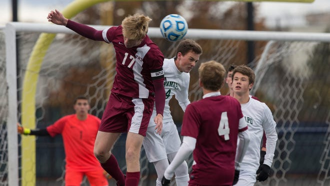 Toms River South's Chris Kluxen battles Ramapo's Bem Landel during first half action.  Toms River South Boys Soccer vs  Ramapo in Group III Final in Union NJ on November 20, 2016.
