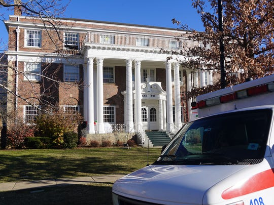 An ambulance sits outside the Chi Psi house in Boulder,