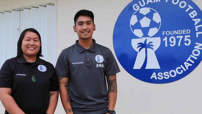 Guam Football Association Media & Marketing Officer Jill Espiritu and National Coach and former National Team Manager Ross Awa pose for a photo recently at the Guam Football Association National Training Center. Espiritu and Awa are among the final selections made by the Asian Football Confederation to take part in the upcoming AFC Football Administration Certificate program, which is specifically catered for future senior management of the AFC Member Associations.