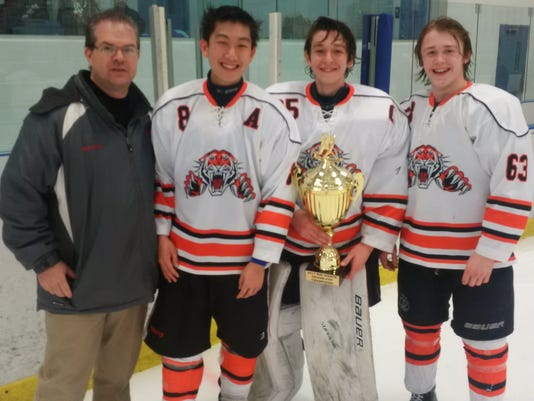Tenafly/Cresskill hockey captains with Silver Cup