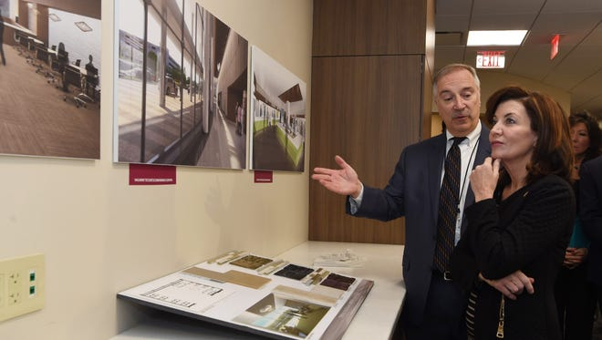 Lt. Gov. Kathy Hochul, right, looks at renderings of the new building at Vassar Brothers Medical Center as Timmian Massie, senior vice president of marketing, public affairs and government relations at Health Quest, directs a tour of the Prototype Experience building on Livingston Street in the city of Poughkeepsie.