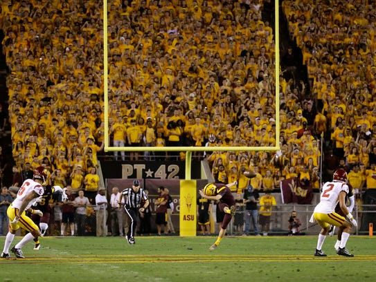 Fans in the Arizona State student section watch the