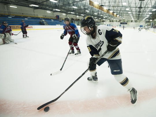 Essex's Sarah Tobey (18) plays the puck during the girls hockey game between Spaulding and Essex at the Essex Skating Facility on Wednesday night February 10, 2016 in Essex.
