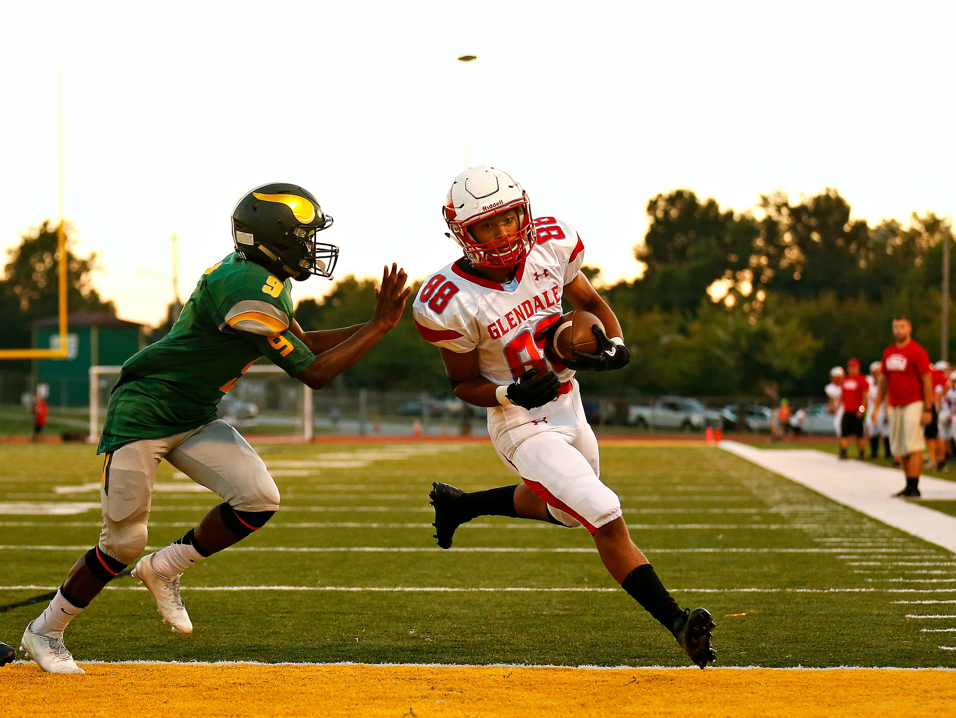 Glendale High School wide receiver Jeremy Almeida (88) runs past Viking defensive back Warren Atkins (9) to score a touchdown during first quarter action of the football game between Glendale High School and Parkview High School at JFK Stadium in Springfield, Mo. on Sept. 22, 2016.