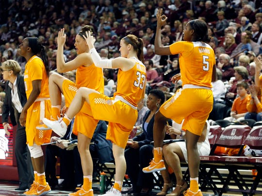 Tennessee players celebrate a three-point basket against Mississippi State in the first half of Sunday's game in Starkville, Miss.