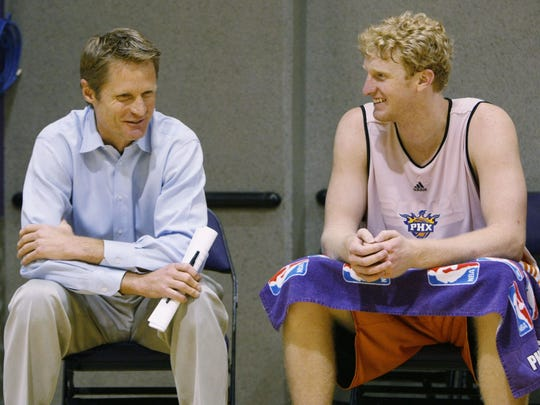Suns President of Basketball Operations and General Manager Steve Kerr talks to Arizona's Chase Budinger (right) after a pre-draft workout at US Airways Center in Phoenix in 2008.