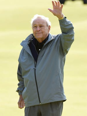 Arnold Palmer takes the applause from the fans on the 18th green at the end of the Champions challenge at the 144th Open Championship at The Old Course at the Royal and Ancient Golf Club of St Andrews.