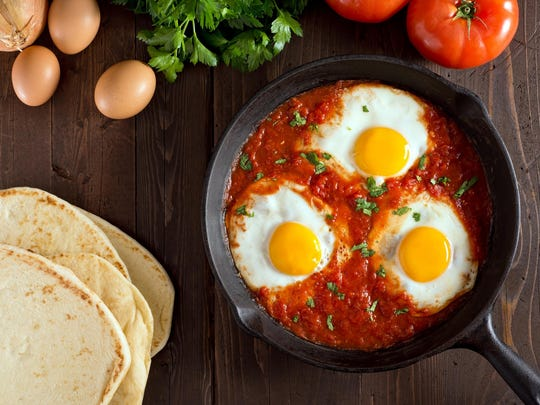 For Tunisian shakshuka, eggs are poached in tomato