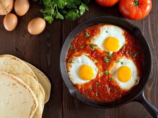 For Tunisian shakshuka, eggs are poached in tomato pepper sauce.