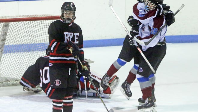 Sam Adler, right, opened the scoring in Rye Town/Harrison's 5-2 win Monday over Rye in a Division II playoff game at Playland Ice Casino.