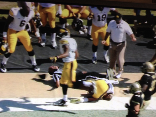 Saturday's field judge got laid out after Iowa's Jonathan Parker was spun out of bounds in the first half.