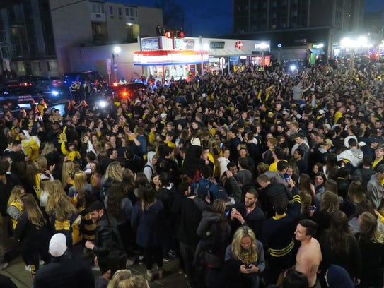Fans celebrate the University of Michigan's 69-57 win