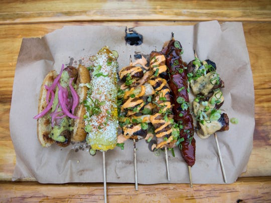 At Lost Whale, Iron Grate's lineup includes sausage on a bun, corn on the cob, mushroom and green onion, pork belly, pork loin and skewered sausage.