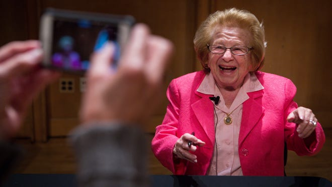 Psychosexual therapist Dr. Ruth Westheimer, smiles for a fan as she signs her latest book after giving a presentation at the Loudis Recital Hall of the Amy E. du Pont Music Building on the University of Delaware campus.