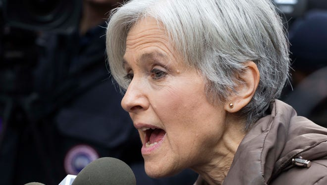 Jill Stein, the presidential Green Party candidate, speaks at a news conference in front of Trump Tower, Monday, Dec. 5, 2016, in New York. Stein has pushed for recounts in the election vote in Wisconsin, Pennsylvania and Michigan. (AP Photo/Mark Lennihan)
