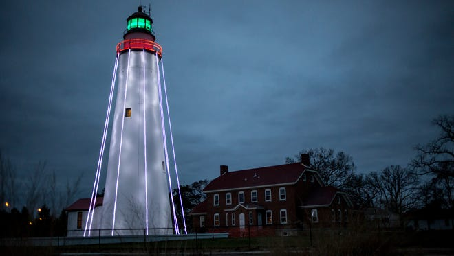 The Fort Gratiot Lighthouse is decorated with lights for the 2016 candlelight tours
