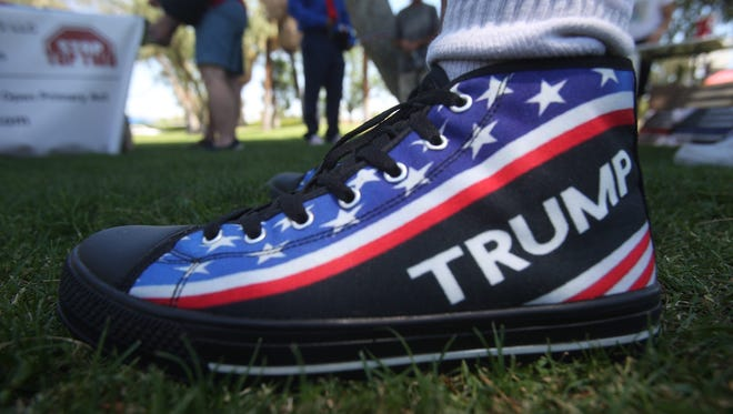 Charles McDonald sports Trump shoes at the #July4Trump rally at Ruth Hardy Park in Palm Springs on July 4, 2017.