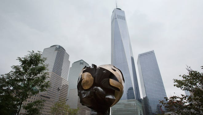 The Koenig Sphere is on display in Liberty Park adjacent to the World Trade Center, Wednesday, Sept. 6, 2017, in New York. The 25-ton, bronze sphere, damaged by the collapsing World Trade Center on Sept. 11, 2001, has been returned to a spot overlooking the rebuilt site. It was made by German sculptor Fritz Koenig in 1971 and was situated on the plaza between the original trade center towers.