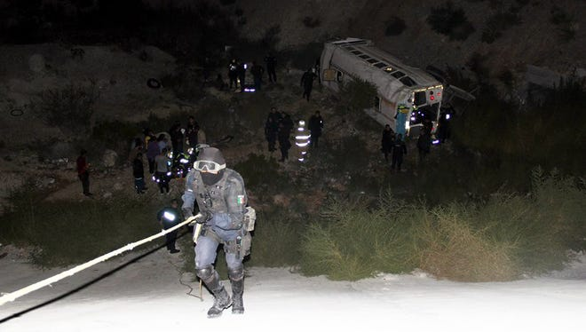 Two maquiladora workers died and 18 more were injured when the bus they were riding to get back home from a factory near the Santa Teresa port of entry fell off a 30-foot-deep cliff early Tuesday in west Juárez.