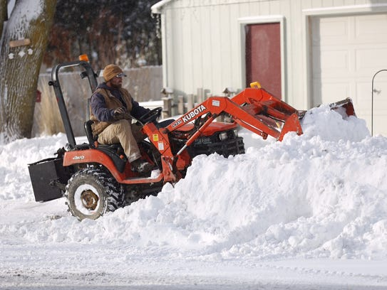 Ross Hackbarth in Waupun uses his frontend loader to