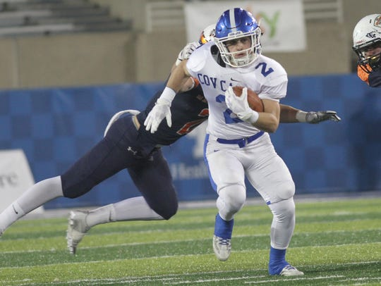 Covington Catholic's Casey McGinness runs the ball