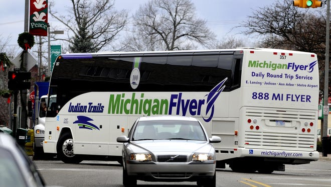 A Michigan Flyer bus leaves downtown East Lansing headed to Detroit Metro Airport after making stops in Ann Arbor.