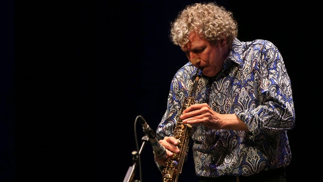 Jazz musician, composer and producer Bob Belden plays soprano saxophone in a performance of the Animation ensemble from the U.S. during the Iranian Fajr International Music Festival at the Vahdat hall in Tehran, Iran on Feb. 19, 2015.