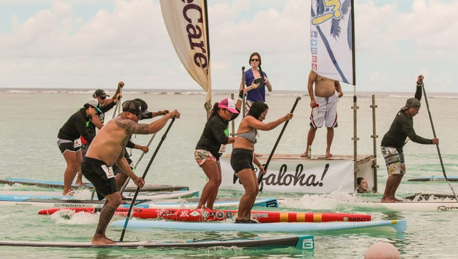 In this file photo, paddlers compete at the SUP Fest Paddleboard Competition at Matapang Beach.